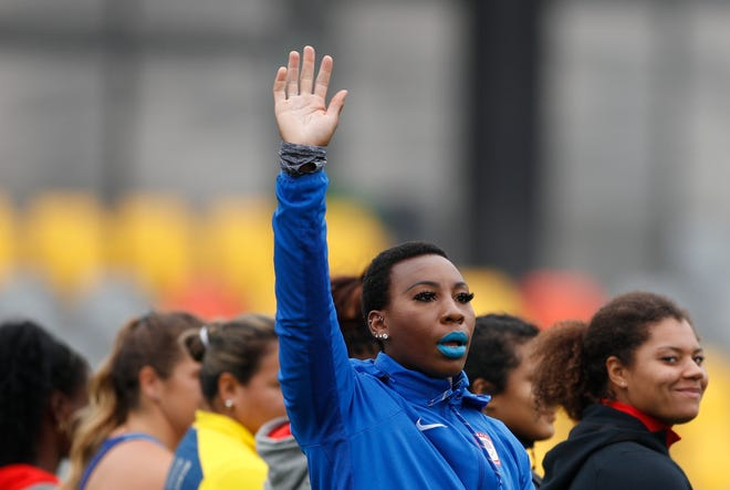 Gwen Berry of the United States waves as she is introduced at the start of the women's hammer throw final during athletics competition at the 2019 Pan American Games in Lima, Peru. In the summer of 2019, U.S Olympic and Paralympic Committee CEO Sarah Hirshland reprimanded Berry and fencer Race Imboden for violating Rule 50, which prohibits inside-the-lines protests at the games, after Berry raised her fist and Imboden kneeled on the medals stand at the Pan-Am Games in Peru.