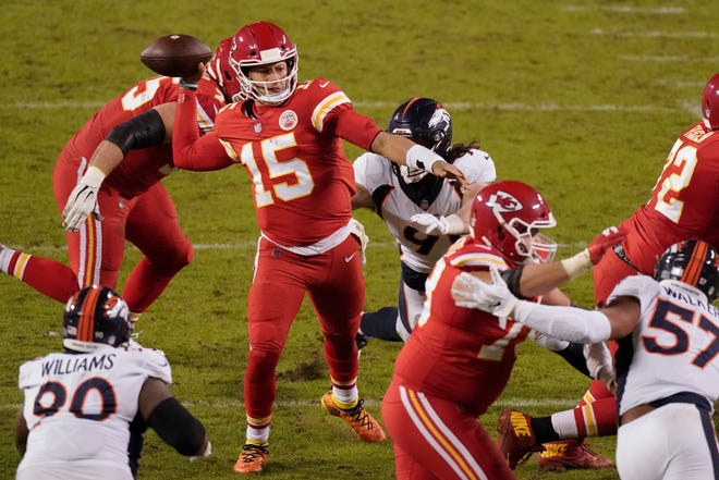 Kansas City Chiefs quarterback Patrick Mahomes (15) throws under pressure against the Denver Broncos during a game last Sunday in Kansas City.
