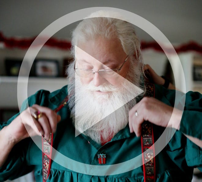 In this file photo, Richard Knapp, or as he prefers to be called, Santa Claus, gets ready for another day of magic, at his daughter's home in Heath, December 4, 2018.