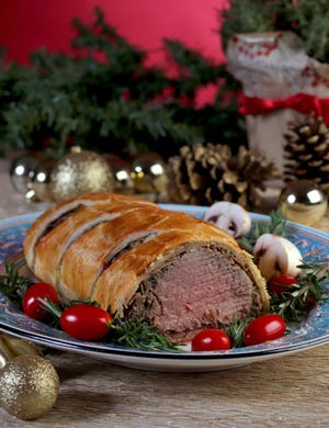 BeefWellingtonbegins with a beef tenderloin, which is wrapped with sauteed vegetables, prosciutto and a puff pastry.