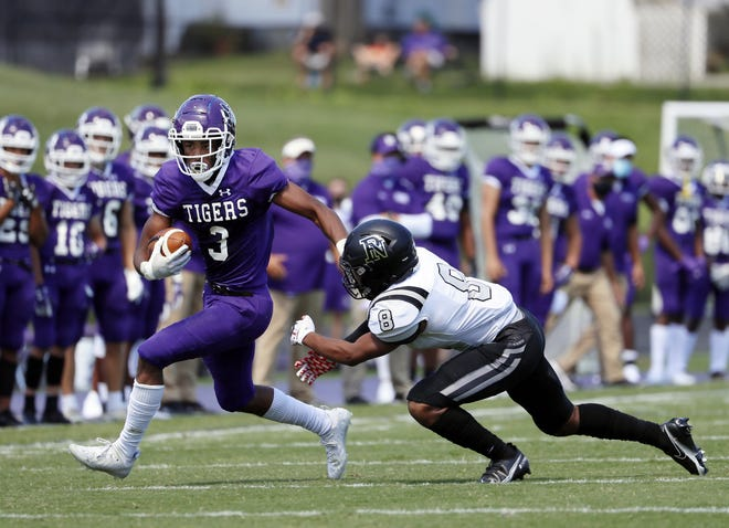 Lorenzo Styles Jr. of Pickerington Central runs for extra yardage after making a catch against Pickerington North on Aug. 30.