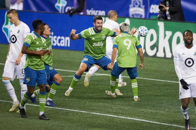 Seattle Sounders forwards Raul Ruidiaz and Will Bruin celebrate after Ruidiaz scored the tying goal in the MLS Western Conference final on Monday.