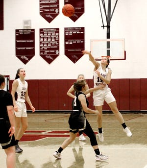 John Glenn's Rachel Meinert (12) attempt a last second shot during Wednesday's MVL game with River View at John Glenn High School. Meinert led the Lady Muskies with a career high 18 points in John Glenn's 64-23 victory.