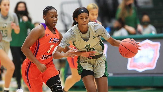 Yazz Wazeerud-Din, right, was impressive in her Stetson debut, scoring a team-high 18 points with five rebounds and five steals. She led the way as five different Hatters scored in double figures. Thursday, Dec. 10, 2020