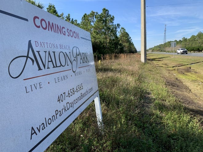 """A """"Coming Soon"""" sign for Avalon Park Daytona can be seen along State Road 40/West Granada Boulevard, across from the entrance to Ormond Beach's Breakaway Trails community on Thursday, Dec. 10, 2020."""