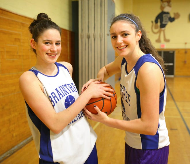 Sisters Brianna and Bridget Herlihy pose for a photo during the Braintree High girls basketball team's run to the 2014 Division 1 state title.