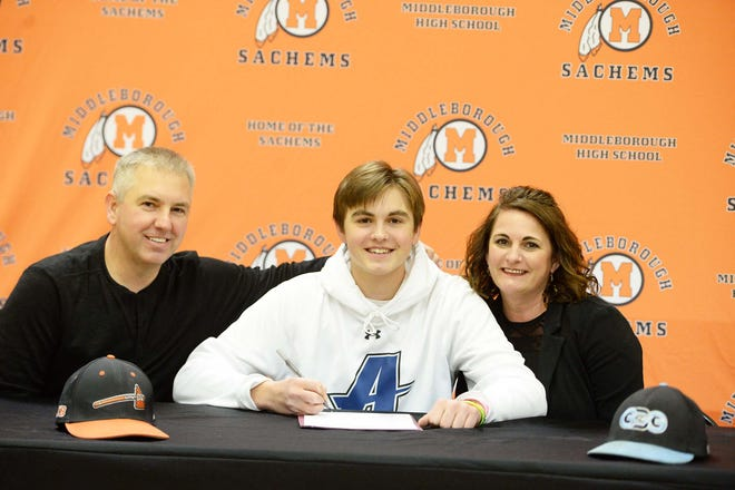 Middleboro senior Justin Plausky, signs his letter of intent to play baseball at Assumption University in a ceremony at Middleboro High School, Thursday, Dec. 10, 2020. He was joined by his parents Mike and CarolAnn.