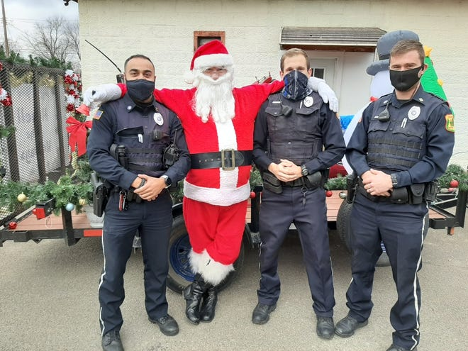 """Santa Claus relaxes with HPD Blue members on Saturday, Dec. 5, when the Jolly Elf visited Hornell. The Hornell Police Department escorted Santa around the city as the Big Guy wished the community a """"Merry Christmas"""" and double checked his naughty or nice list. Sources tell The Spectator that every child in the city is on Santa's """"nice list"""" this holiday season. Santa will be back in town this Saturday, beginning at 1 p.m., for a final ride around the city, and organizers want to express their gratitude to the City of Hornell and the Hornell PD for assistance during Santa's visits."""