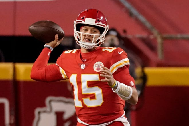 Kansas City Chiefs quarterback Patrick Mahomes throws against the Denver Broncos in Sunday's game. The 22-16 win clinched a playoff berth for the Chiefs.