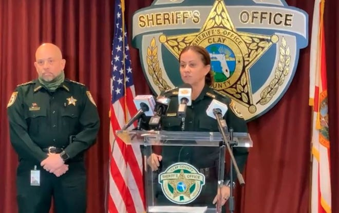 Clay County Sheriff Michelle Cook (center) joins Undersheriff Ron Lendvay to announce the arrest of a deputy on organized-fraud charges.