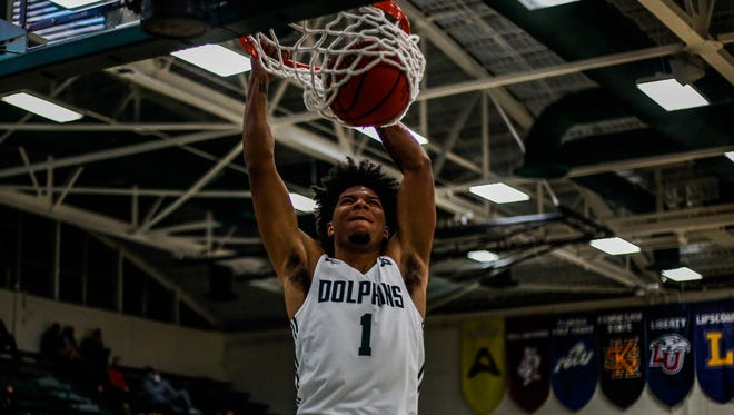 Jacksonville University's Diante Wood dunks during Wednesday's 78-69 victory over Florida National at Swisher Gym.
