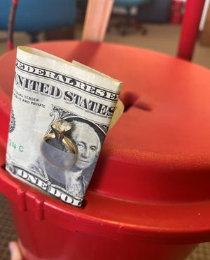 Something special was dropped in a Salvation Army kettle on Dec. 1 in Jacksonville — this diamond ring taped to a dollar bill.