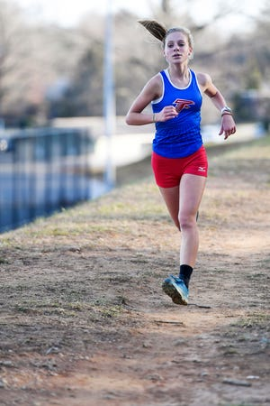 West Henderson's Bre Budzinski finished in first place in Wednesday's cross country meet at Jackson Park in Hendersonville.