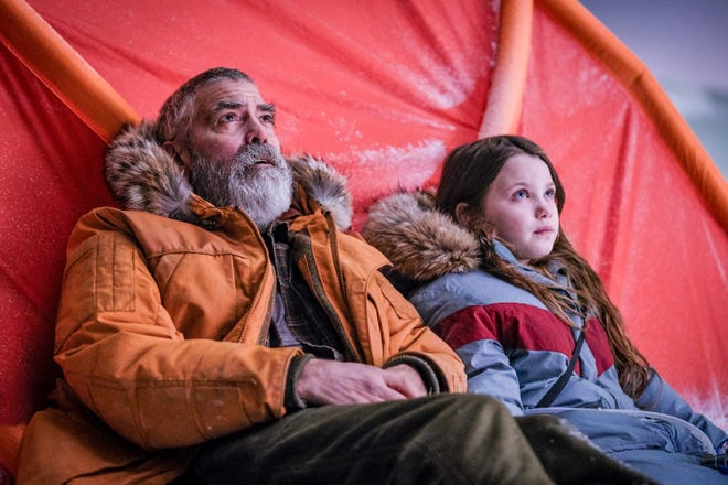 """This image released by Netflix shows Caoilinn Springall, right, and George Clooney in a scene from """"The Midnight Sky."""""""
