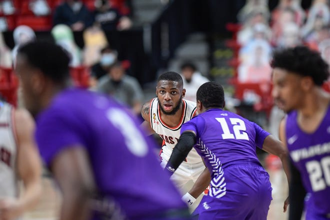 Texas Tech's Jamarius Burton looks for an open teammate to pass to ball to during a nonconference game Wednesday against Abilene Christian at United Supermarkets Arena. Burton committed six turnovers and is looking to bounce back when the No. 17 Red Raiders take on Texas A&M-Corpus Christi at 1 p.m. Saturday at the Comerica Center in Frisco.