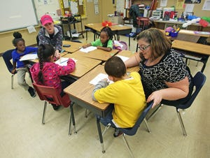 Teachers Jennifer Giles and Nichole Perrett work with young students in this Ledger file photo at Janie Howard Wilson Elementary in Lake Wales , Florida. [Pierre DuCharme/The Ledger]