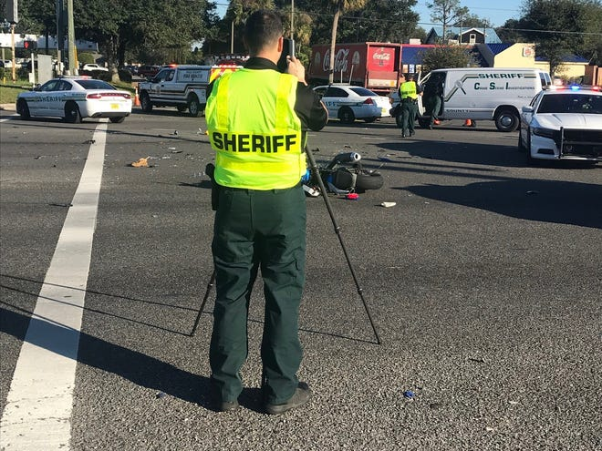 Members of the Polk County Sheriff's Office conduct their investigation into a fatal motorcycle crash in Mulberry on Wednesday afternoon.