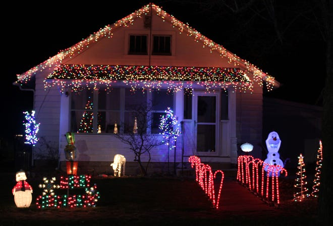 A house on S. Johnson Street is brightly lit for the holidays. This display across Macomb is among more than two dozen displays across the city in the self-directed Tour of Lights.