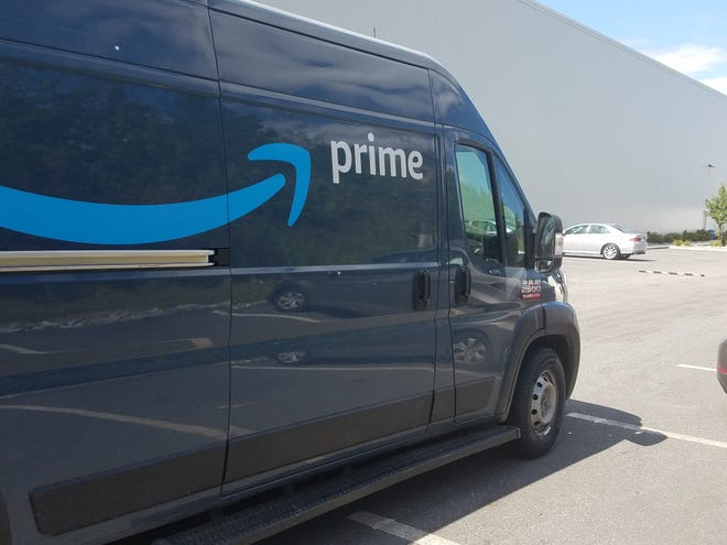An Amazon delivery truck heads out of the parking lot of the company's fulfillment center on Industrial Road in Milford last year. [Daily News file photo]
