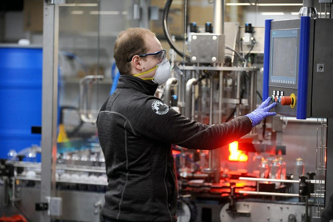 David Zamarin, founder and CEO of DetraPel Inc., works inside the company's Blandin Avenue production facility in April 2020, bottling its ecoCleaner and disinfectant formula.