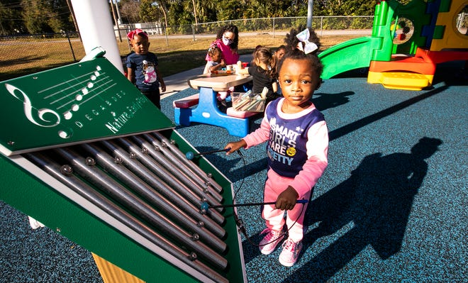 Jayda Washington, 2, plays the xylophone on Thursday at Episcopal Children's Services' new playground at the Thelma Griffith Early Head Start Center in Ocala.