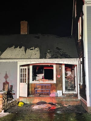A fire in an attic caused damage to a a house, Dec. 10, 2020, on River Street in Norwell.