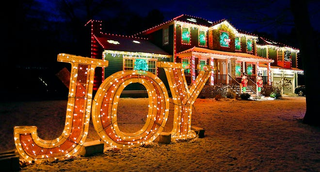 David Strenge of Marshfield, who has decorated his Valley Path home with over 4,000 lights. He has done so for six years, fulfilling a childhood dream.