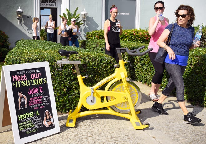 Participants leave the studio after a SoulCycle class at Royal Poinciana Plaza in 2017. (Melanie Bell / Palm Beach Daily News)