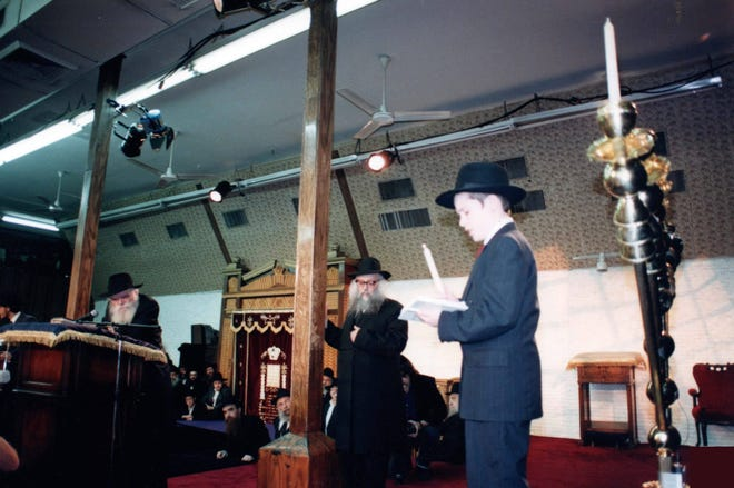 In 1991, Rabbi Zalman Levitin lights the Chanukah Menorah in the presence of the Chabad-Lubavitcher Rebbe, Rabbi Menachem M. Schneerson at 'Chanukah Live' at the Chabad world headquarters in Brooklyn.
