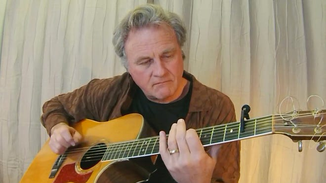 """A veteran of 6,000 live gigs, Maine performer Harvey Reid has recently published a study of solo self-accompanied traveling singers. """"The Troubadour Chronicles"""" is now available in paper or ebook format on Amazon.com. [Courtesy photo]"""
