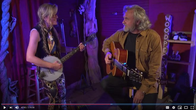Troubadour couple Joyce Andersen and husband Harvey Reid perform a virtual concert at the Puffin and Loon Lounge in their barn in York, Maine. [Courtesy photo]
