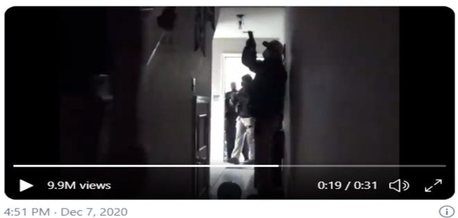 Still of video footage released Dec. 7 by Rebekah Jones of the Florida Department of Law Enforcement raid on her home.