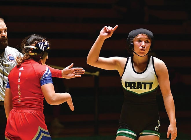 Pratt wrestler Jadyn Thompson motions to take top as she works her way to victory and first place in the 115-120 lb.combined weight class.