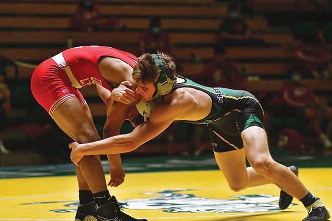 Pratt High School wrestler Lucas Baker makes a single leg point move, earning points for the Greenbacks in early season matches.