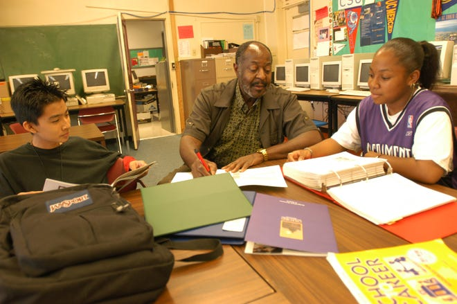 Educator and civic leader Benjamin Reddish Jr., center, spent more than 40 years teaching the students of the Stockton Unified School District.