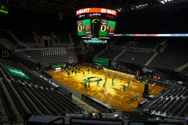 Oregon and Florida A&M players warm up before their game in an empty Matthew Knight Arena on Wednesday.