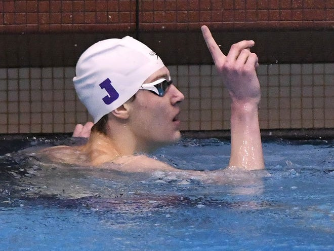 Jackson's Aiden Neuman holds up a fingeer after winning the 200-meter IM during last year's Division I district swim meet. This year, both the Polar Bears' boys and girls teams are 4-0 in dual matches heading into the new year.