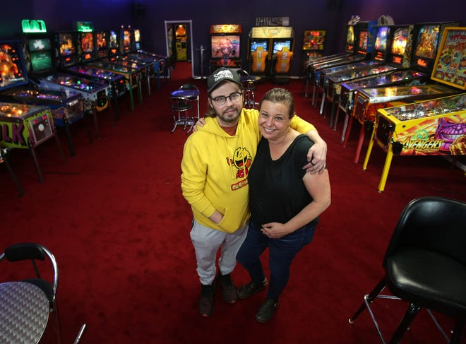 Dustin and Julie Myers are the owners of Rack It Up, a new video game and pinball arcade in Plain Township.