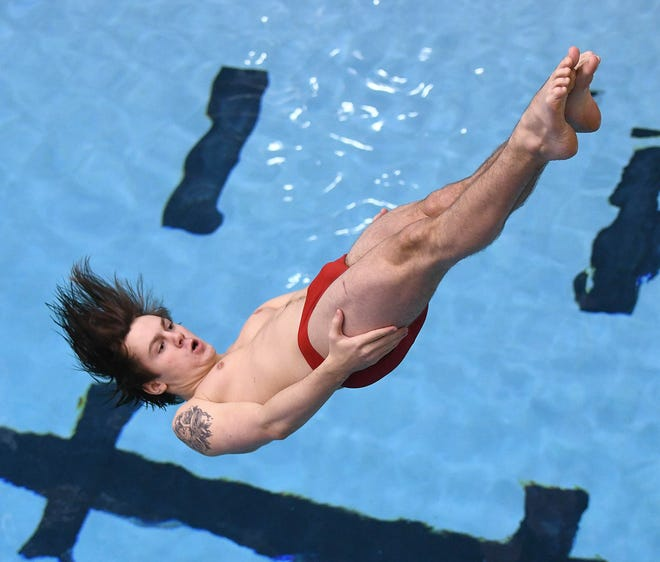 Jackson junior Zach Schering competes in the Northeast Division I District Diving Meet,  Feb. 13, 2020. (CantonRep.com / Ray Stewart)