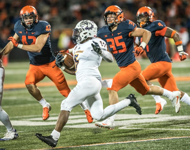 Western Illinois' Steve McShane (5), a Freeport High School graduate, runs the ball as he is pursued by Illinois defenders on Sept. 8, 2018, in Champaign.