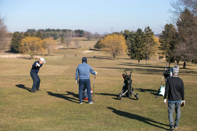 Golfers tee off from the first tee at Elliot Golf Course on Thursday, Dec. 10, 2020, in Rockford. It marked the last day the course was open and all fees were waived.