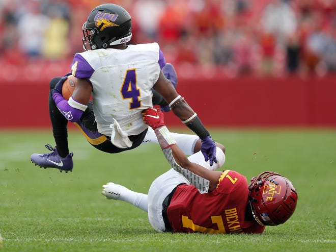 Iowa State defensive back Justin Bickham, right, pulls down Northern Iowa wide receiver Deion McShane during the second overtime on Aug. 31, 2019, in Ames, Iowa. Iowa State won 29-26 in triple overtime.