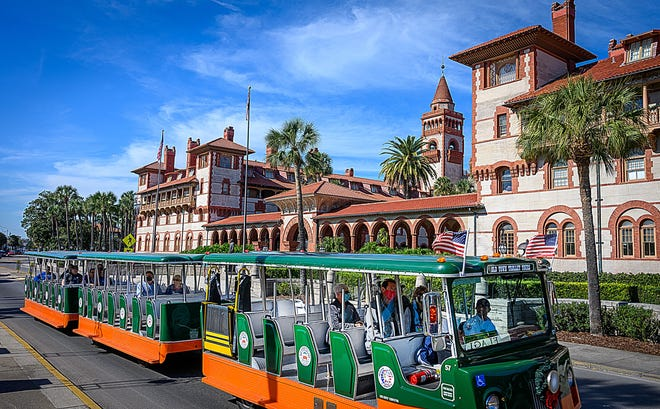 Visitors to St. Augustine ride an Old Town Trolley down King Street in front of Flagler College on Thursday, Dec. 10, 2020.