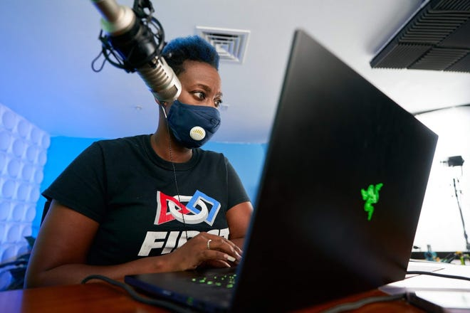 Neirda Lafontant, an engineer and founder of FUNducation, hosts a Facebook livestream of FUNducation's first robotics season at Sarasota Underground. Credit Pat Laughrey
