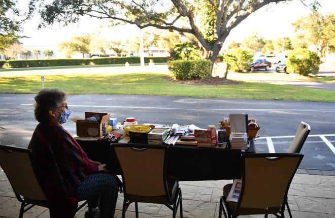 Joanne Maguire staffs a table at Temple Emanu-El's Outdoor Hanukkah Market. The gift shop also has in-store hours by appointment with masks and social distancing.
