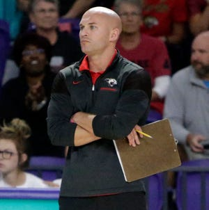 Cardinal Mooney coach Chad Sutton watches the action against Westminster Christian in the FHSAA Class 3A state volleyball final Saturday at Florida SouthWestern State College in Fort Myers.