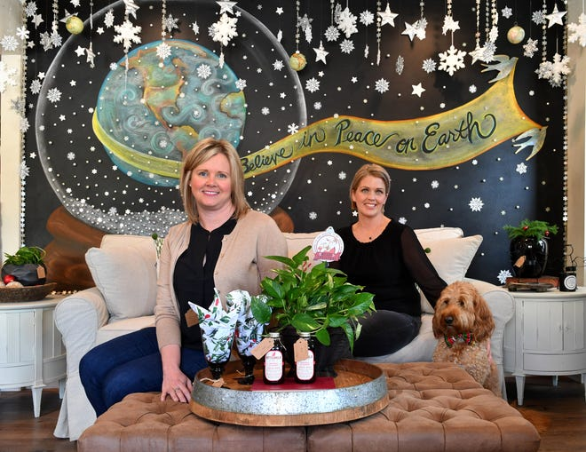 Shawna Taylor, left, and Stacie Pardue, co-owners of The Bungalow, a home boutique store, and their shop dog, Wyatt, sit in front of a mural painted by local artist Cynthia Hoeksema. They change the mural every quarter, along with their inventory, to coincide with the changing of the seasons. The Bungalow is at 2419 Manatee Ave. W. in Bradenton.