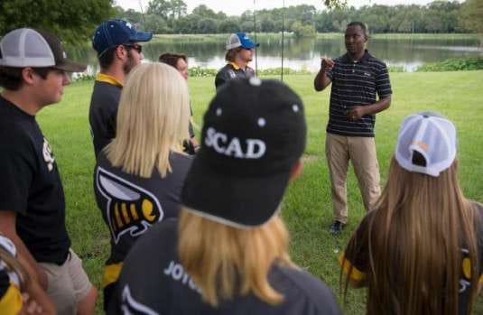 Isaac Payne, head coach of SCAD's men's and women's fishing teams, gives instructions to members of the teams before an afternoon practice at Lake Mayer in October 2016.