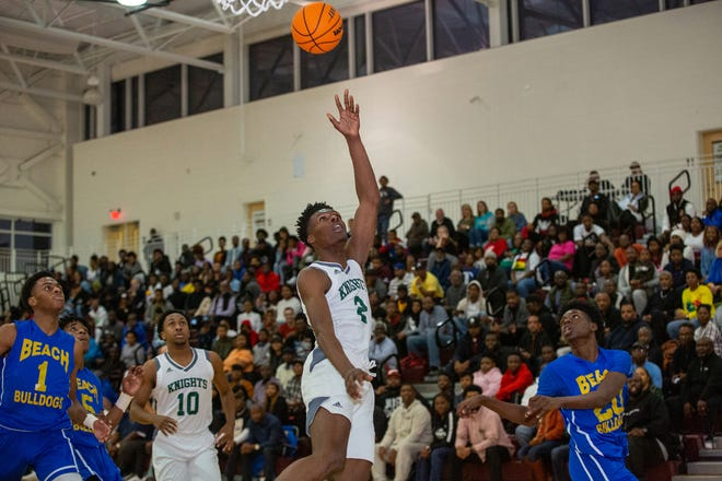 Windsor Forest's D'Ante Bass lays the ball up against Beach during the Region 3-3A championship game last season at New Hampstead.