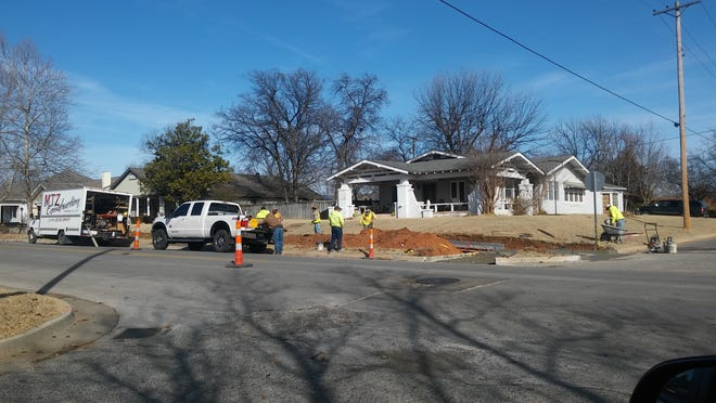 During Phase 2 of an Avedis Foundation's sidewalk project in February 2018, contractors were making sidewalk improvements along Broadway, heading north. Crews are shown making progress at the northeast corner of Broadway and Severn.